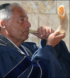 Right face Rabbi blowing shofar